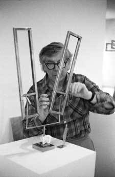 George Rickey adjusting and testing the balance and movement of a maquette