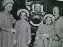 Frederick B Snite, Jr, in his iron lung with his wife, Tessie, and their three daughters in 1949