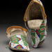 Lakota (American, Wyoming and Montana Territories), <em>Pair of Adult Moccasins</em>, ca. 1880-1890, deerskin, sinew, beads, and cloth, 11 x 4 x 4 inches. Gift of Rev. E.W. J. Lindesmith, AA1899.019