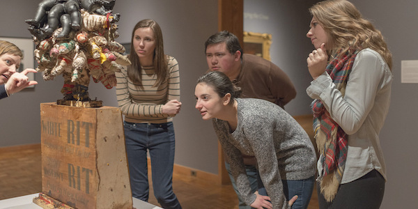 ND students looking at a Vanessa German sculpture recently purchased by the Snite Museum of Art for its collection.