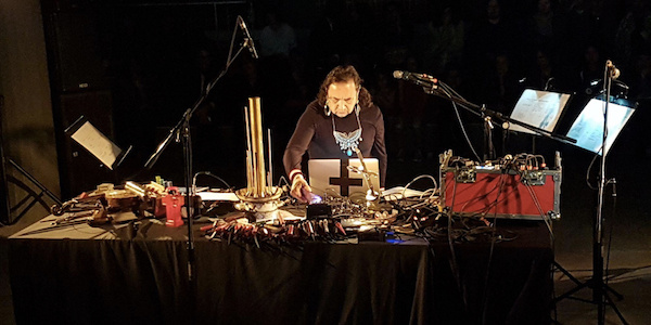 Artist and experimental composer Guillermo Galindo performing.